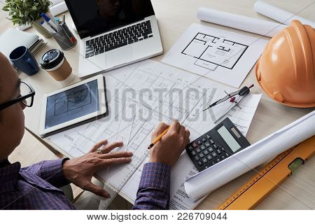 Architect Working On Construction Project At His Table