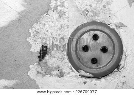 Old Electrical Socket For A Radio On A Dilapidated Wall