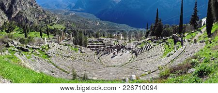 Ruins Of The Ancient Temple Of Apollo At Delphi, Overlooking The Valley Of Phocis.