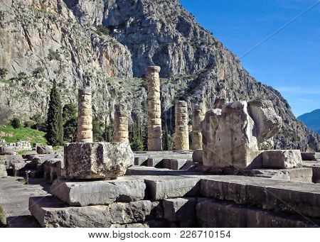Ruins Of The Ancient Temple Of Apollo At Delphi, Overlooking The Valley Of Phocis, Greece