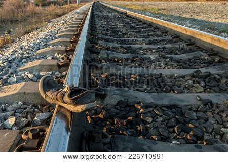 Shoes Dirty And Old Lying On Rails, Railway Accident