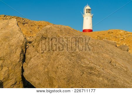 Portland Bill Lighthouse Seen From The Rocks Near Pulpit Rock, Jurassic Coast, Dorset, Uk, Jurassic