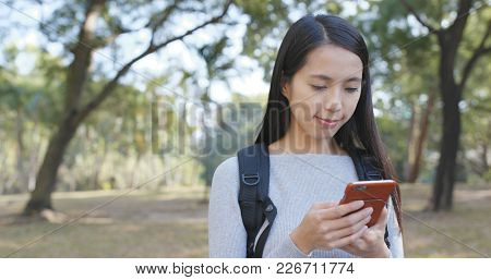 Woman using smart phone at outdoor