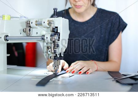 Craftswoman Searching For Ideas In Internet Using Gadget, Seamstress Wants To Make Extraordinary Lea