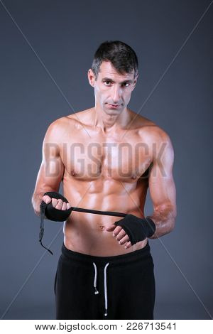 portrait of hand wrapping half nude boxer. Personal fitness instructor. Personal training.