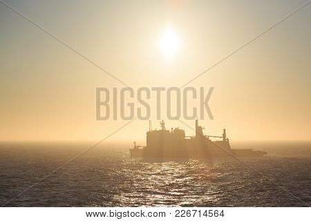 Shmidta, Chukotski Region, Russia - Settlement Shmidta, July 13, 2017: Ice Breaker Tajmyr On Sunrise
