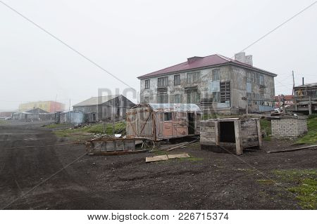 Uelen, Chukotski Region, Russia - Settlement Uelen, June 28, 2017: Street With Old Houses And Sheds.
