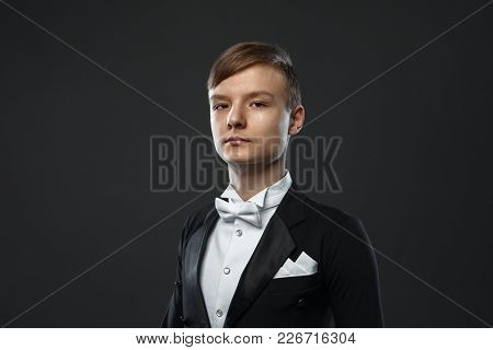 Teenage Boy In The Evening Dress On A Black Background