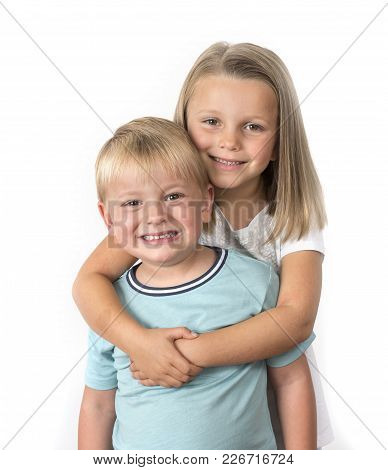 7 Years Old Adorable Blond Happy Girl Posing With Her Little 3 Years Old Brother Smiling Cheerful Is