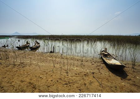 Wooden Boat Of Local Fishermen Stretching Shallow Water River In Gia Lai, Central Highlands Of Vietn