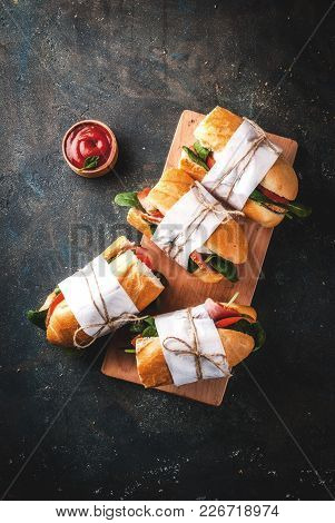 Fresh Baguette Sandwich With Bacon, Cheese, Tomatoes And Spinach, Dark Blue Background Copy Space To