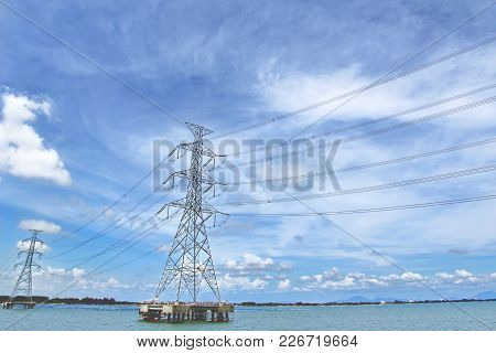 High Voltage Transmission Line Across The Sea To The Sky, The Clouds Are Beautiful.