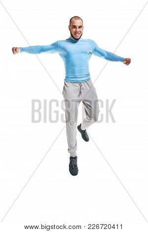 Healthy Fit Man Warming-up And Jumping On White Background