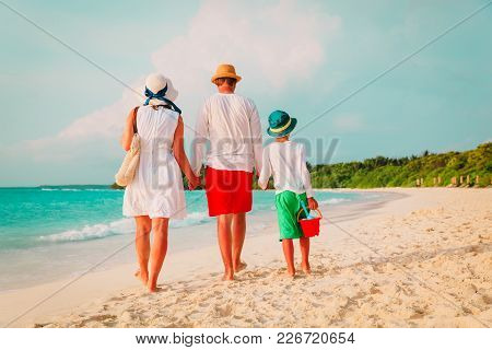 Family With Child Walking On Tropical Beach, Vacation Concept