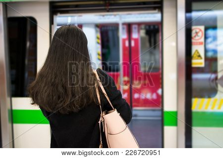 Girl Entering Metro At A Subway Station