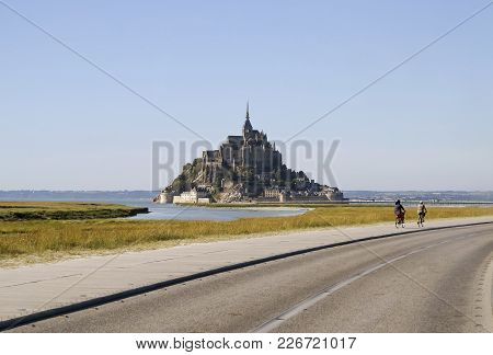 Norman Benedictine Abbey Of St Michel At The Peak Of The Rocky Island, Surrounded By The Winding Str