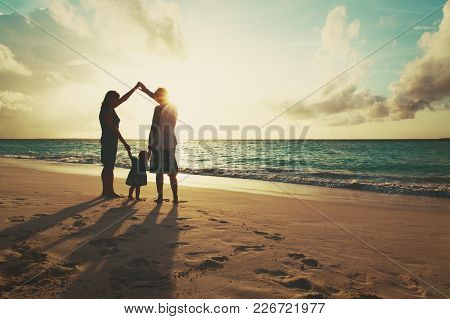 Happy Family With Child Play On Sunset Beach, Parenting Concept