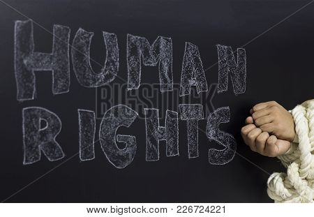 Written The Word Human Rights With Knotted Hand On The Blackboard