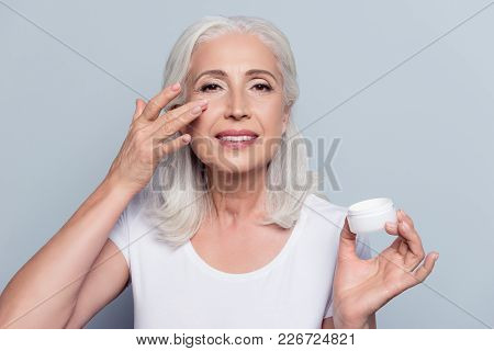 Perfect, Pretty, Woman Applying Eye Cream, Holding Jar Of Cosmetic Product Looking At Camera Over Gr