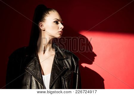 Attractive Stylish Girl Posing For Fashion Shoot On Red