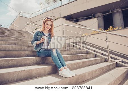 Concept Of Having Free Wireless Connection. Beautiful Cheerful Excited Woman Sitting On Stairs In Ci