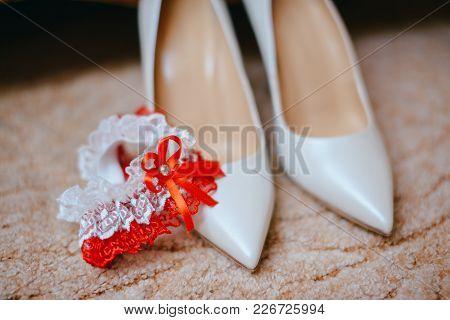 Elegant White Bride Shoes And Bridal Bouquet. Wedding Accessories.the Bride's Garter