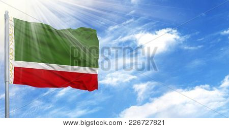 Flag Of Chechen Republic On Flagpole Against The Blue Sky.