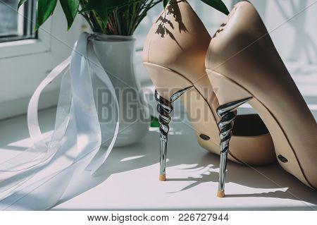 Elegant Cream Bride Shoes And Bridal Bouquet. Wedding Accessories