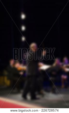 Orchestra Conductor  Manages The Orchestra.  Musical Concept. Blurred Background. Background For Des