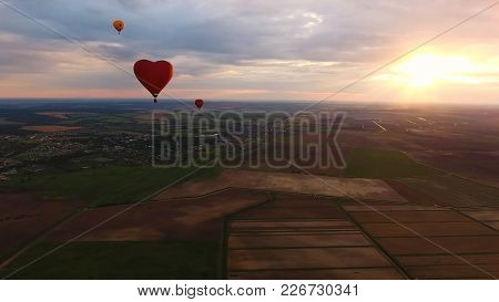 Aerial View Hot Air Balloons In The Sky Over A Field In The Countryside In The Beautiful Sky And Sun