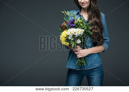 Cropped View Of Girl In Denim Clothes Holding Bouquet Of Flowers For International Womens Day, Isola