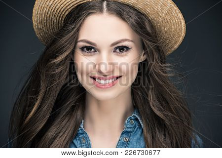Attractive Smiling Girl With Long Hair In Straw Hat, Isolated On Grey