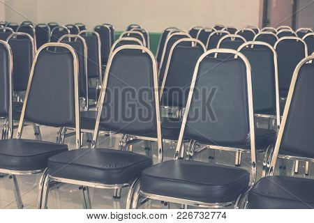 Rows Of Empty Black Leather Chairs In A Meeting Room, Indoor Modern Meeting Room.