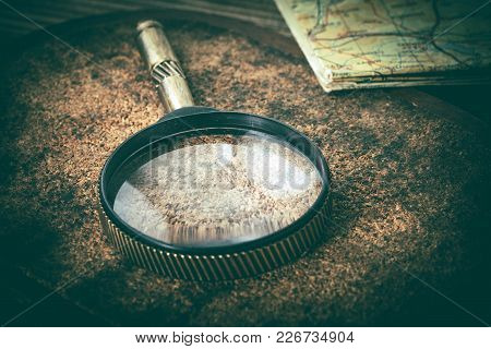 Old Magnifying Glass Or Loupe On Cork Background.