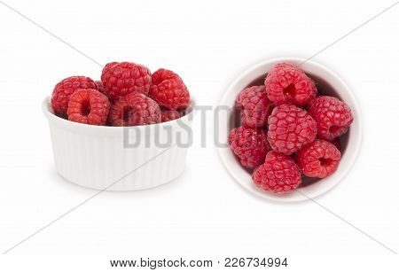 Set Of Red Raspberries. Raspberries In A Bowl Isolated On White Background. Vegetarian Or Healthy Ea