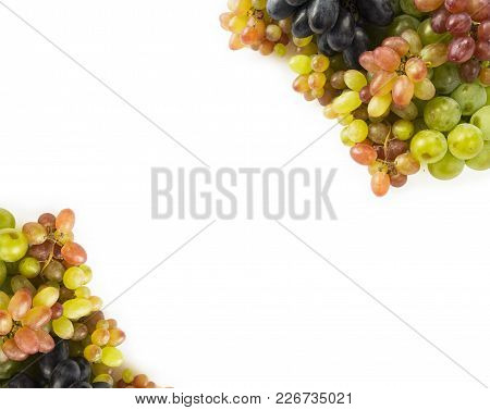Top View. Grapes On White Background. Grapes With Copy Space For Text. Blue, Red And Green Grapes. V
