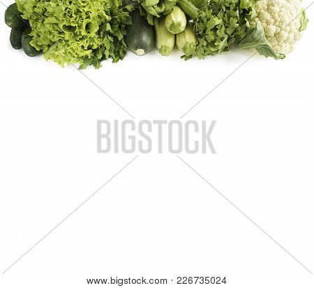 Top View. Variety Of Green Vegetables And Fruits On White. Cucumber, Cauliflower, Zucchini, Arugula