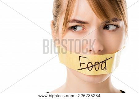 Young Woman With Stick Tape With Striked Through Word Food Covering Mouth Isolated On White