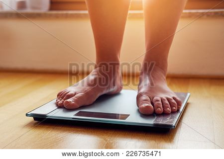 Female Bare Feet On Weight Scale