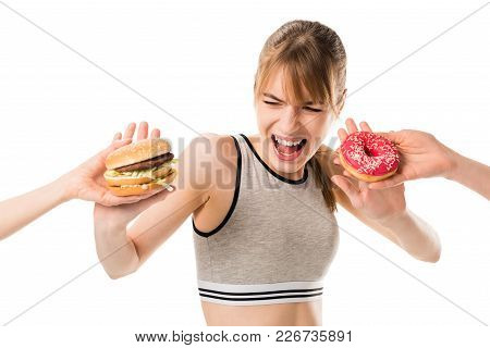 Young Slim Woman Refusing Of Junk Food Isolated On White