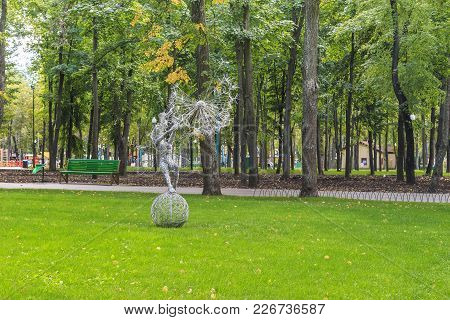 Kharkov, Ukraine - September 5, 2017:  It Is The Sculpture Of Elf With Dandelion On A Green Lawn In