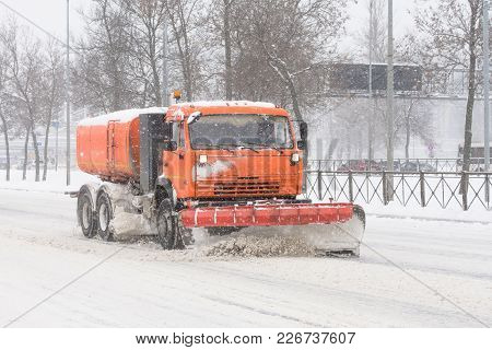 Road Cleaning Snow-removing Machine In The City After Huge Snowfall