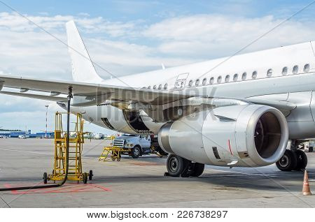 Fueling Aircraft, View Of The Wing, Hose, Engine Airport Service