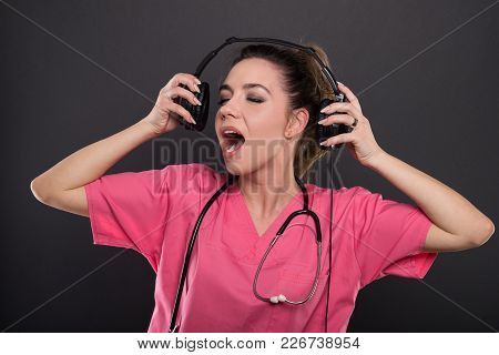Beautiful Young Doctor Singing Listening To Headphones