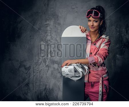 Cute Modern Female Posing With A Snowboard On Grey Background.