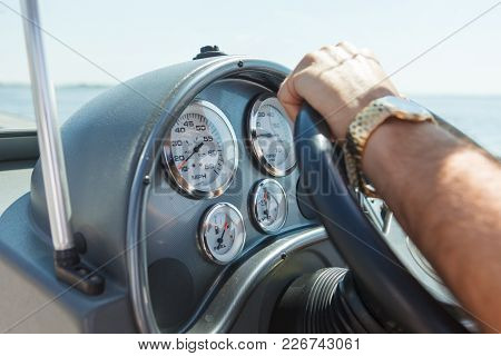 Devices Of Navigation And Sensors Of Speed, Battery, Fuel, Tachometer, Speedometer On The Tourist Bo
