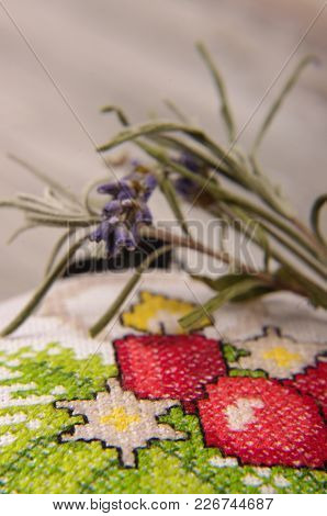 Macro Close Up Of Levande Blooms And Branch And Cross Stiched Bag