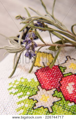 Macro Close Up Of Levander Blooms And Branch And Cross Stitched Bag