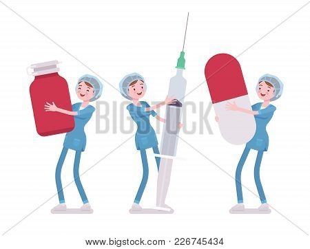 Female Nurse And Big Tools. Young Woman In Hospital Uniform Holding Giant Drug Box, Syringe, Pill. M