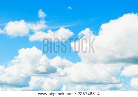 Blue Sky Background With White Clouds Lit By Sunlight. Natural Blue Sky Background. Blue Sky Backgro